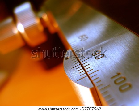 precision measurement tool made of steel, inches and millimeter, detail photo