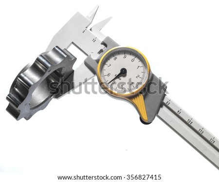 precision measuring machine part with a caliper  - stock photo