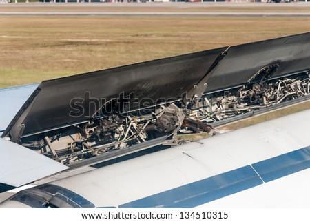precision mechanics inside a vintage aircraft engine - Detailed exposure of a turbo jet engine - stock photo