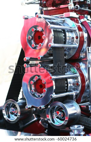 Precision muscle car engine that produce intense horsepower and incredible speed. Used in race cars and automotive show cars. - stock photo