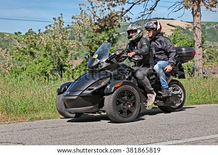"PREDAPPIO, ITALY - MAY 10: biker riding three-wheeled vehicle BRP Can-Am Spyder Roadster in motorcycle rally ""Mototagliatella"" on May 10, 2015 in Predappio, Italy"
