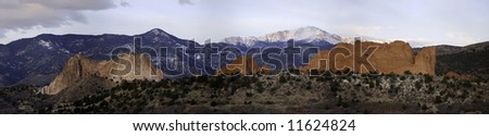 Predawn panoramic view of the Garden of the Gods. A snow-covered Pikes Peak looms in the background. - stock photo