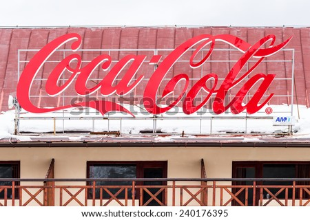 PREDEAL, ROMANIA - DECEMBER 23, 2014: Coca-Cola Advertising on Apartment Building With Snow. Is a carbonated soft drink sold in stores and restaurants in every country except Cuba and North Korea.
