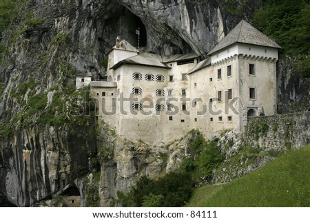 Predjama Castle in Slovenia, built on a high cliff and with the large cave behind it - stock photo