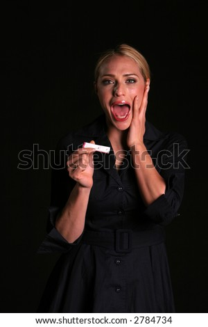 pregnancy concepts upset a young woman is shocked and upset at the news of being pregnant - stock photo