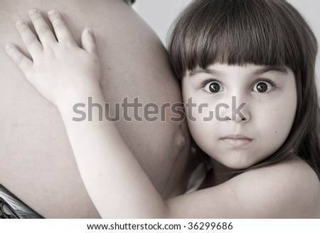 Pregnancy Mother and very surprised child
