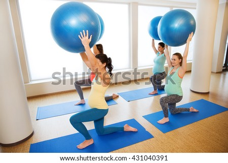 pregnancy, sport, fitness, people and healthy lifestyle concept - group of happy pregnant women exercising with ball in gym - stock photo