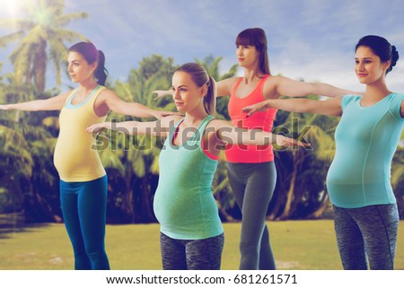 pregnancy, sport, fitness, people and healthy lifestyle concept - group of happy pregnant women exercising in gym