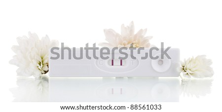 pregnancy test and flowers isolated on white - stock photo