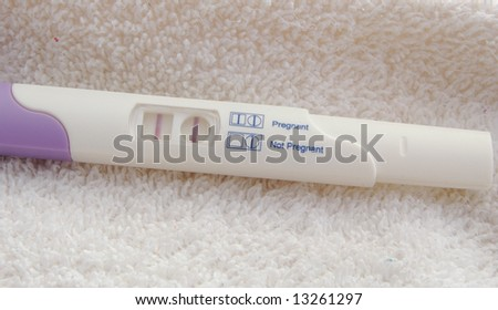 pregnancy test kit showing positive