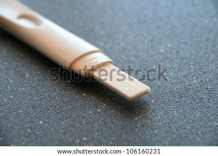pregnancy test on black background - stock photo