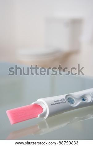Pregnancy testing kit in bathroom - stock photo
