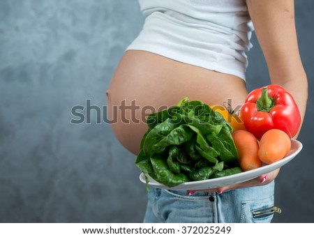 Pregnancy, waiting for baby. Portrait of young and attractive pregnant woman with healthy food. Pregnant female healthy motherhood concept - stock photo