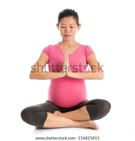 Pregnancy yoga class. Full length healthy Asian pregnant woman doing yoga exercise stretching, full body isolated on white background. Yoga positions lotus prayer..