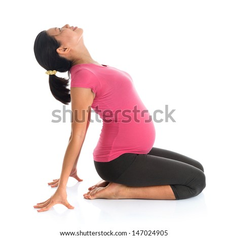 Pregnancy yoga. Full length healthy Asian pregnant woman doing yoga exercising stretching, full body isolated on white background.  - stock photo