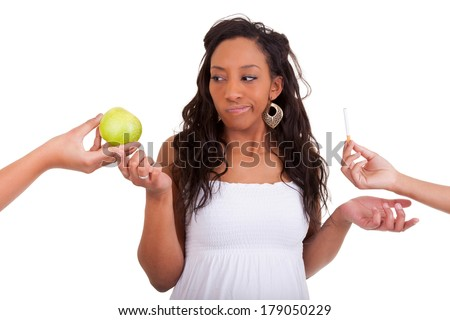 Pregnant african american woman refusing a cigarette nd choosing an apple - Black people, over white background - stock photo