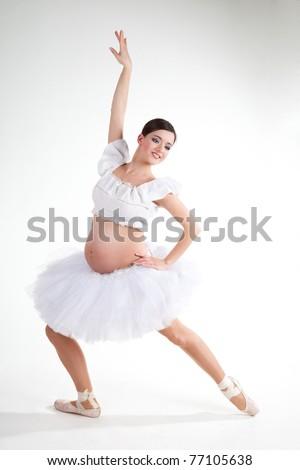 Pregnant ballet dancer over white background - stock photo