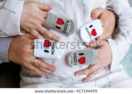 Pregnant belly with hands of mother and father Pregnancy