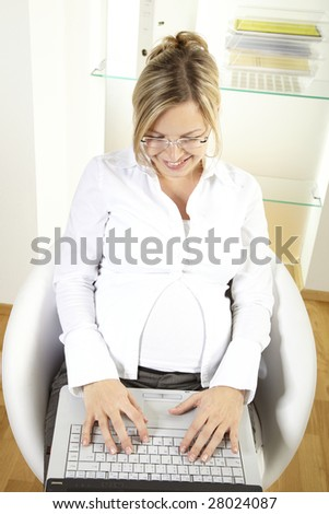 pregnant businesswoman - stock photo