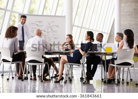 Pregnant Businesswoman At Boardroom Meeting - stock photo