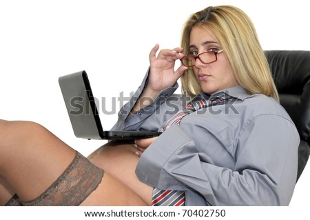 Pregnant businesswoman with laptop isolated in white