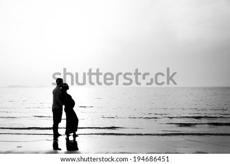 Pregnant couple on Sunset Beach, Dubai - stock photo