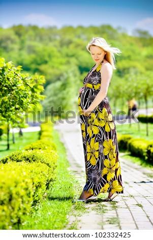 Pregnant female in park - stock photo