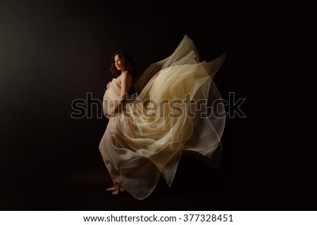 Pregnant girl.Beautiful girl.the girl waiting for a miracle.the girl waiting for appearance of the child.pure girl.naked pregnant girl.the pregnant girl in a chiffon dress. - stock photo
