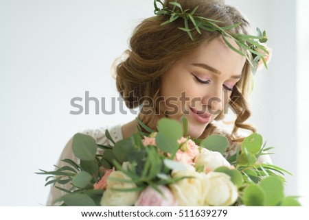 Pregnant girl with a bouquet of flowers