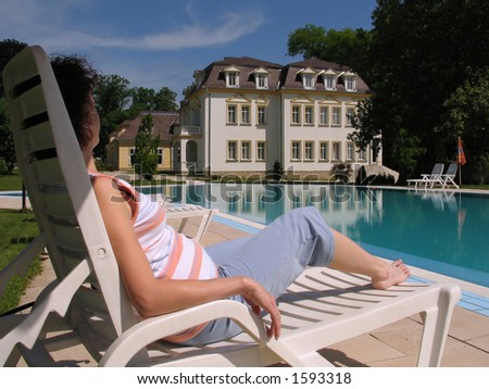 Pregnant Lady Relaxing at the Pool