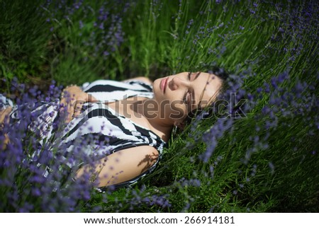 Pregnant lovely woman in sunny summer day - stock photo