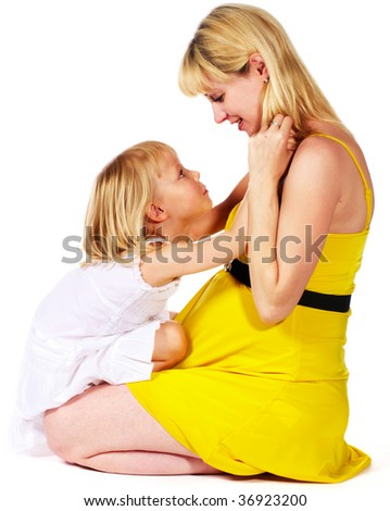 pregnant mother with her daughter playing - stock photo