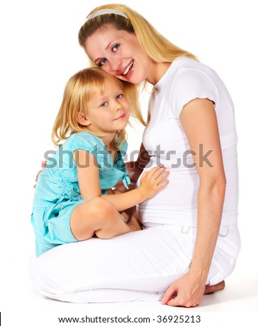 pregnant mother with his daughter sitting - stock photo