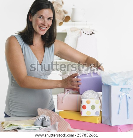 Pregnant Woman at Baby Shower - stock photo