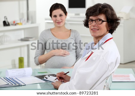 Pregnant woman at the doctors - stock photo