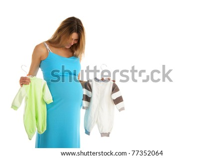 pregnant woman buying baby clothes isolated on white - stock photo