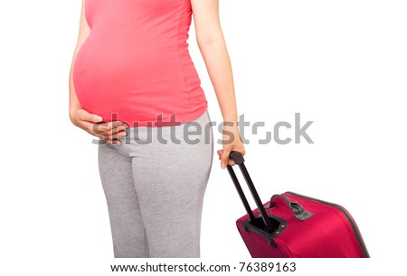 Pregnant woman carrying suitcase and ready for maternity hospital - stock photo
