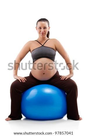 Pregnant woman doing exercises - stock photo