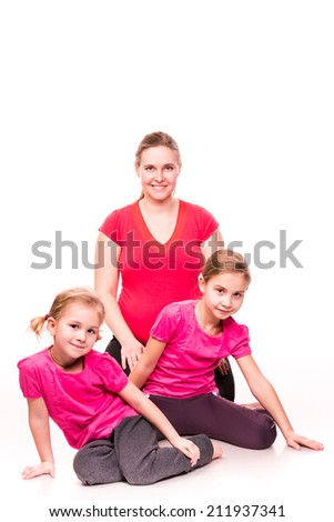 Pregnant woman doing gymnastic exercises with kids isolated over white background, active and sportive pregnancy, healthy motherhood concept - stock photo