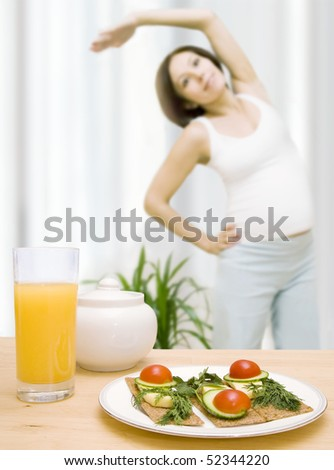 Pregnant woman doing morning exercises