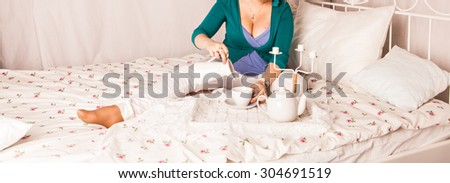 Pregnant Woman Drinking Hot Drink At Home - stock photo