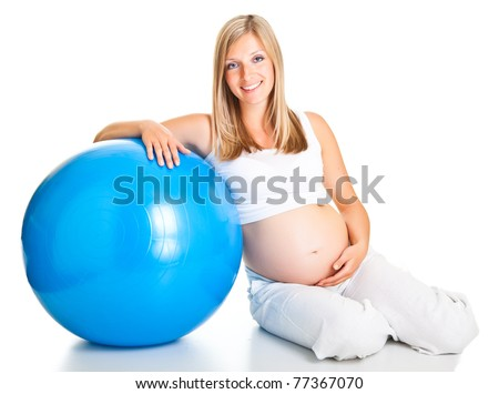 Pregnant woman excercises with gymnastic ball - stock photo