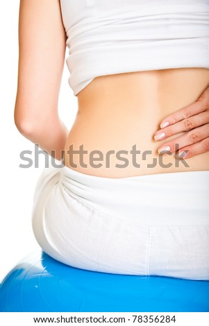 Pregnant woman excercises with gymnastic ball back pain