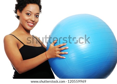 Pregnant woman exercises with big blue gymnastic ball - stock photo