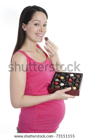 Pregnant woman holding box of chocolates