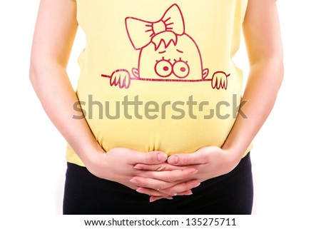 Pregnant woman holding her belly - stock photo