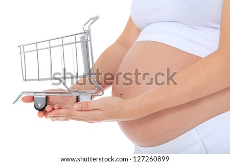 Pregnant woman holding shopping cart. All on white background. - stock photo