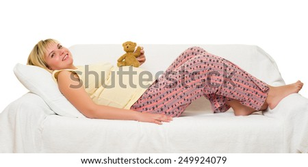 Pregnant woman in bed. White background