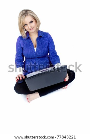 Pregnant woman in home office with laptop  smiling - stock photo