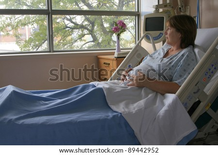 Pregnant woman in the hospital bed awaiting the birth of a child. - stock photo
